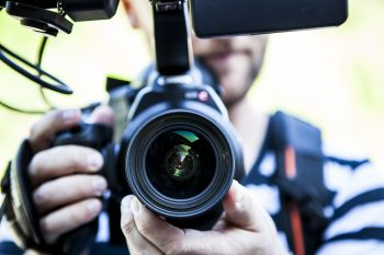 Image of a man holding a video camera