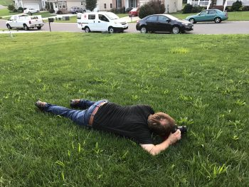 Mark on the ground with a camera, getting a unique angle at a shoot