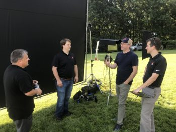 Mark and the Production Team discussing the plan at a shoot
